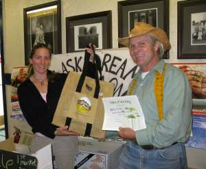 Julie Jordan of Alaska Dream Salmon receives the Table of the Day award from Kerry MacLane for the first Sitka Farmers Market of the season