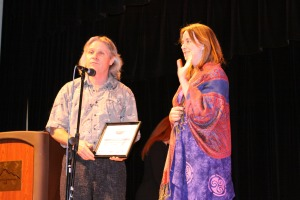 Sitka Local Foods Network president Kerry MacLane, left, and secretary/treasurer Linda Wilson say a few words after the Sitka Local Foods Network received a Community Wellness Champion award for nutrition at the 2009 Sitka Health Summit