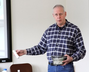 Master gardener Bob Gorman shows off seed starts in wet paper towels during a March garden workshop
