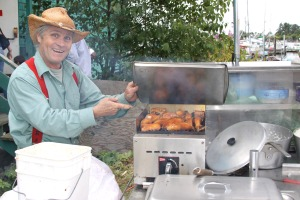 Kerry MacLane grills black cod for the Alaska Longline Fisherman's Association booth at the Sitka Farmers Market