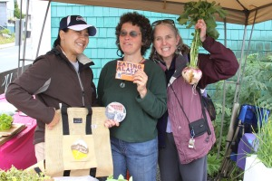 Maybelle Filler, left, Ellen Frankenstein, center, and Lisa Sadleir-Hart at the Sitka Local Foods Network booth.