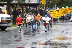 A pack of kids takes off at the start of the 2009 Running of the Boots on Sept. 26
