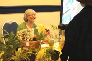 Karen Christner sells plants and local food items on Aug. 29, 2009