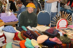 Lisa Bykonen and her knitted hats