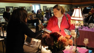 Daily Sitka Sentinel photo of Kiki Norman, left, selling jewelry to Annie Satterly during the final Sitka Farmers Market of the 2009 summer on Sept. 12 at ANB Hall