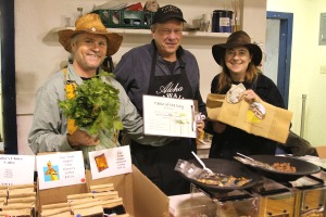 Mike Wise, center, of Raven's Peek Roasters and Sailor's Choice Coffee receives the Table of the Day Award from Kerry MacLane, left, and Linda Wilson, right, during the fifth and final Sitka Farmers Market of the 2009 summer on Sept. 12.