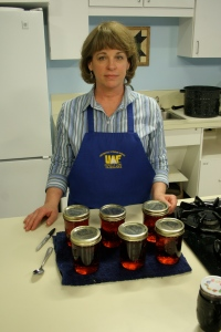 Dr. Sonja Koukel of the UAF Cooperative Extension Service's Juneau office displays some wild berry preserves