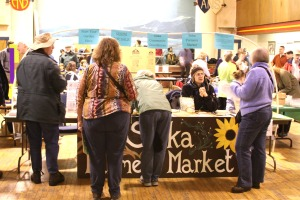 Doug Osborne answers questions at the Sitka Farmers Market table during the 2009 Let's Grow Sitka garden show