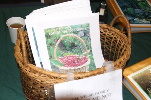 A basket of Florence Welsh's books for sale at Let's Grow Sitka!