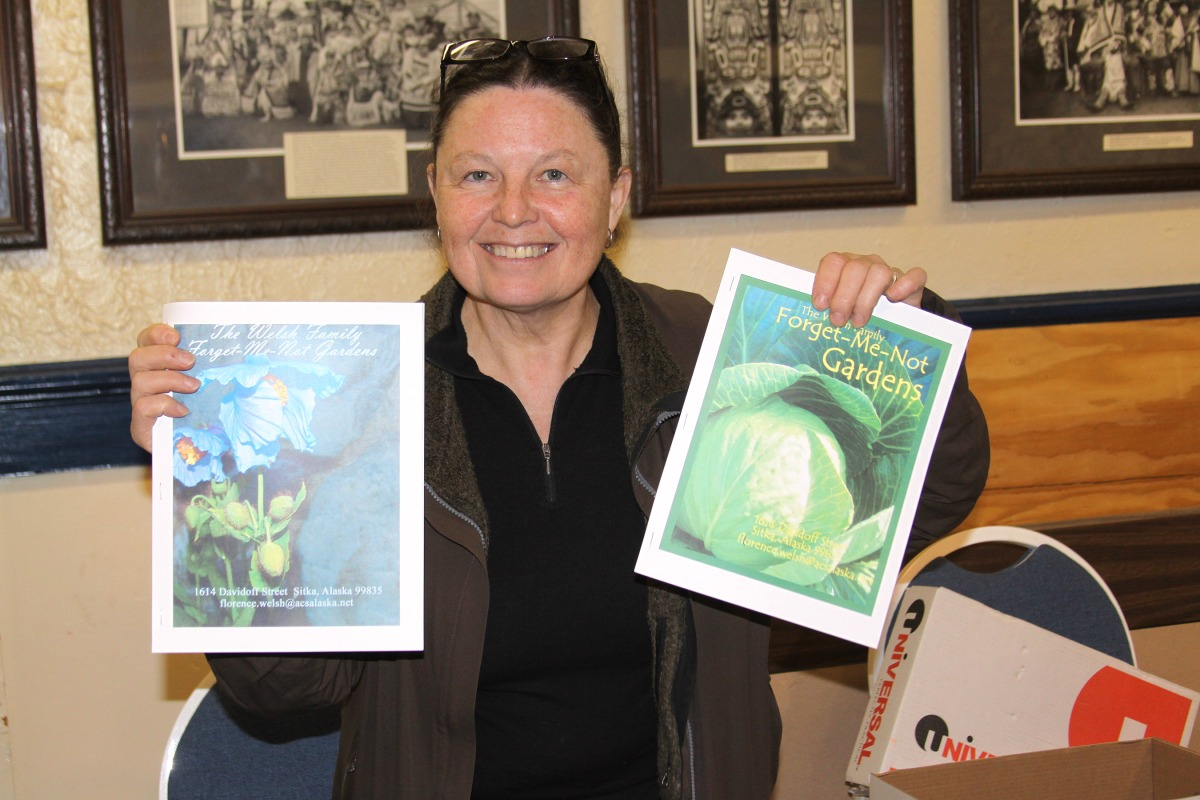Florence Welsh with copies of her Sitka gardening book