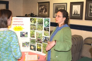 Renee Pierce, right, explains the first Sitka CSA venture to Sitka Local Foods Network board member Natalie Sattler during the Let's Grow Sitka! event on March 14