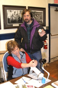 Sonja Koukel of the UAF Cooperative Extension Service's Juneau office checks pressure gauges for Perry Edwards of Sitka