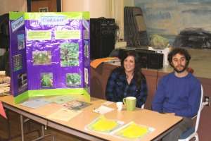Tracy Sylvester (left) and Jesse Remund staff the Endless Summer Ecological Garden and Landscape information booth at Let's Grow Sitka on March 14, 2010