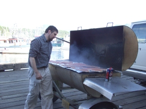 Grillmaster Rick DeGroot checks salmon fillets barbecuing for a 2007 prostate cancer awareness event in Sitka