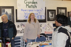 Michelle Putz of the Sitka Global Warming Group staffs the garden match booth at the Let's Grow Sitka event on March 14, 2010