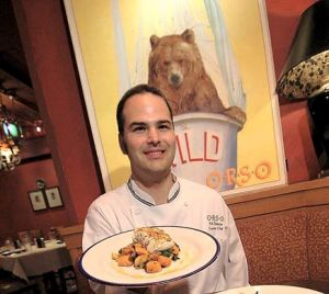 Chef Robert Kinneen of Orso Ristorante in Anchorage shows off an entrée featuring fresh Alaska yelloweye rockfish (Alaska Journal of Commerce photo by Rob Stapleton)