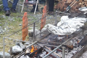 King salmon fillets and baked potatoes cook over an open fire at an open house and salmon bake hosted by Medvejie Hatchery on July 10, 2010.