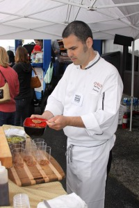 Guest chef Robert Kinneen of Anchorage demonstrates a dish using scallops during the first Sitka Seafood Festival in 2010.