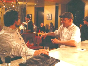Josh Peavey, right, talks over Baranof beer at a recent all-Alaskan dinner at Bayview Restaurant and Wine Bar in Sitka. The entire menu down to the butter and the bread was made by Peavey with only Alaskan ingredients. (Courtesy Photo Josh Peavey)