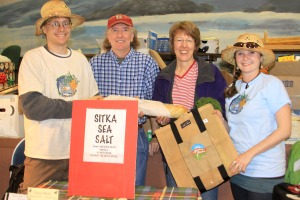 PHOTO COURTESY OF SITKA LOCAL FOODS NETWORK  Sitka Local Foods Network Board Member Doug Osborne, left, and Sitka Farmers Market Co-Director Mandy Griffith, right, present the Table of the Day Award to Dave Nicholls, second from left, and Charlotte A. Vanchura Candelaria of Sitka Sea Salt during the first Sitka Farmers Market of the summer on Saturday, July 16, 2011, at the Alaska Native Brotherhood Hall in Sitka, Alaska. Sitka Sea Salt is a new business that will manufacture sea salt for chefs and restaurant use. Dave and Charlotte received a tote bag full of bread, veggies and other prizes from the market. The next Sitka Farmers Market is from 10 a.m. to 2 p.m. on Saturday, July 30, 2011, at ANB Hall. To learn more about the Sitka Farmers Market, go to http://www.sitkalocalfoodsnetwork.org/.
