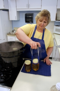 University of Alaska Fairbanks Cooperative Extension Service Tanana District Agent Roxie Dinstel demonstrates proper home canning techniques (Photo courtesy of the UAF Cooperative Extension Service)