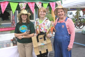 PHOTO COURTESY OF SITKA LOCAL FOODS NETWORK  Sitka Local Foods Network board vice president Linda Wilson, left, and former SLFN board member Lynnda Strong, right, present Amanda Hershberg, owner of The Cupcake Bar by Twinflower Sugar Craft, with the Table of the Day Award from the fourth Sitka Farmers Market of the season on Saturday, Aug. 27, 2011, at the Alaska Native Brotherhood Hall. The prize included fresh produce, preserves and a set of Alaska Grown tote bags. The fifth and final Sitka Farmers Market of the season is from 10 a.m. to 2 p.m. on Saturday, Sept. 10, at ANB Hall (235 Katlian St.). There will be a smaller market held as part of the annual Running of the Boots fundraiser for the Sitka Local Foods Network on Sept. 24 at the Crescent Harbor Shelter.