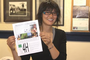 Sitka Conservation Society Community Sustainability Organizer Tracy Gagnon holds a flier introducing a new 4H club for Sitka.