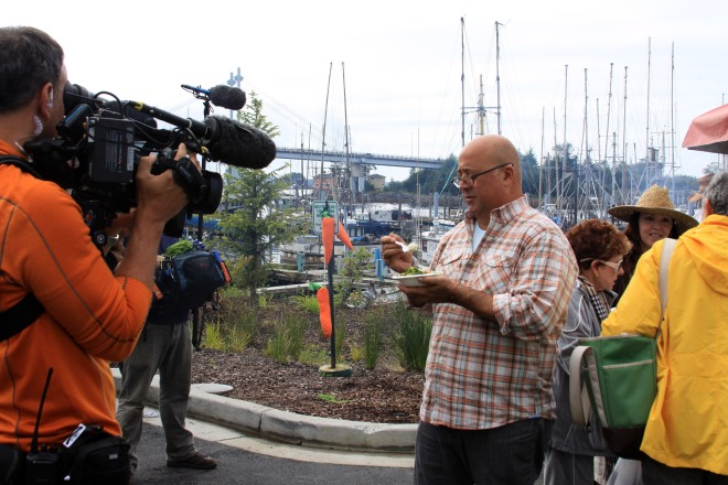 TV personality Andrew Zimmern is filmed as he samples some blackcod tips during the Aug. 18, 2012, Sitka Farmers Market.