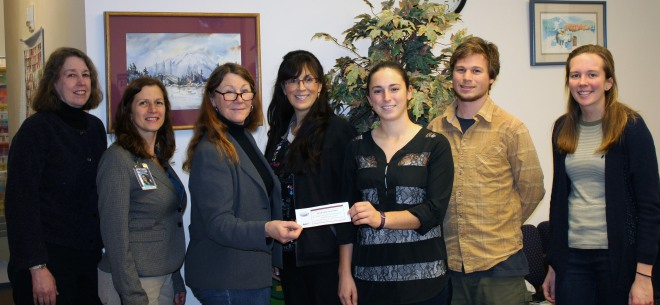 FOOD ASSESSMENT DOUGH: From left, Sitka Health Summit Steering Committee members Ellen Daly, Elisabeth Crane and Penny Lehmann present a check for project seed money to representatives from the Community Food Assessment for a Food Resilient Sitka community wellness project, Renae Mathson (fourth from left), Sabrina Cimerol, Garrett Bauer and Courtney Bobsin.
