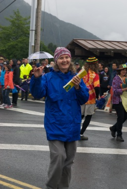 "Sitka Local Foods Network Board Vice President Cathy Lieser distributes ""Alaska Grown"" bumper stickers during the July Fourth parade in Sitka (Photo by Heike Hüttenkofer)"