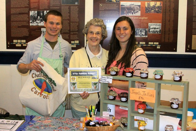 PHOTO COURTESY OF SITKA LOCAL FOODS NETWORK Sitka Farmers Market Co-Managers Garrett Bauer, left, and Sabrina Cimerol, right, present the Table Of The Day Award to Jean Frank of Jeans Jellies Etc. at the second market of the season on Saturday, July 20, at the Alaska Native Brotherhood Founders Hall in Sitka. Jean has been a regular vendor at the Sitka Farmers Market since it started, selling jellies, jams, honey and more. She received a gift bag with fresh produce, fresh rhubarb jam and a copy of the Alaska Farmers Market Cookbook. This is the sixth year of Sitka Farmers Markets, hosted by the Sitka Local Foods Network. The next market is from 10 a.m. to 1 p.m. on Saturday, Aug. 3, at the Alaska Native Brotherhood Founders Hall, 235 Katlian St. For more information about the Sitka Farmers Markets and Sitka Local Foods Network, go to http://www.sitkalocalfoodsnetwork.org/.