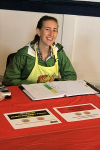 Mira Vale staffs the EBT Quest Card table at the Aug. 3, 2013, Sitka Farmers Market
