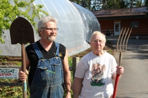 Former Sitka Local Foods Network President Kerry MacLane, left, and Sprucecot Gardens Owner Judy Johnstone pose in front of one of the high tunnels recently erected on Judy's land on Peterson Street. (Photo Courtesy of KCAW-Raven Radio)