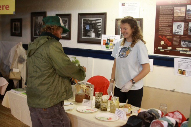 McLane Ritzel, the Sitka Local Foods Network's 2014 summer Bulldogs on Baranof intern, hosts a fermentation demonstration during the Sitka Farmers Market.