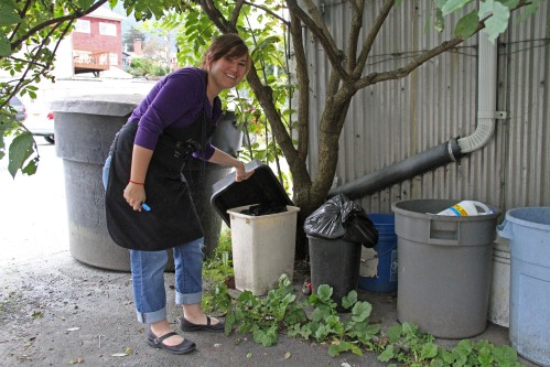 Alana Peterson shows where gardeners can find used coffee grounds from the Back Door Café.