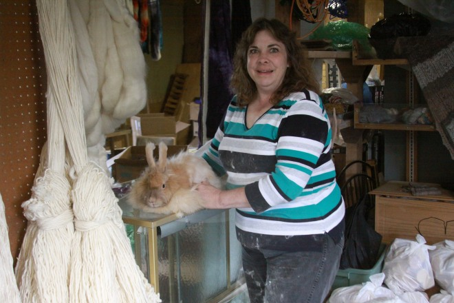 Bobbi Daniels of The Sawmill Farm grooms a rabbit at The Sawmill Farm Feed and Fiber store on Katlian Street. Bobbi raises some rabbits for their hair (to make yarn) and others for meat.