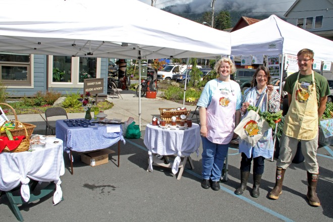 Sitka Farmers Market Manager Debe Brincefield, left, and Sitka Farmers Market Assistant Manager Francis Wegman-Lawless, right, present the Table Of The Day Award to Linda Wilson of Sea View Garden at the third Sitka Farmers Market of the 2015 summer on Saturday, Aug. 1, at the Alaska Native Brotherhood Founders Hall in Sitka. Wilson is a longtime vendor at the market, selling rhubarb and other veggies from her garden, rhubarb jams and jellies, banana bread, rhubarb black tea, and her homemade jewelry. Wilson received a gift bag with fresh greens and fresh rhubarb. This is the eighth year of Sitka Farmers Markets, hosted by the Sitka Local Foods Network. The next market is from 10 a.m. to 1 p.m. on Saturday, Aug. 15, at the Alaska Native Brotherhood Founders Hall, 235 Katlian St. Don't forget Aug. 2-8 is National Farmers Market Week, so even though we don't have a full market scheduled the Sitka Local Foods Network will host a produce booth at the Sitka Seafood Festival Marketplace from noon to 6 p.m. on Saturday, Aug. 8, at Sheldon Jackson Campus. For more information about the Sitka Farmers Markets and Sitka Local Foods Network, go to http://www.sitkalocalfoodsnetwork.org/ or check out our Facebook page at https://www.facebook.com/SitkaLocalFoodsNetwork. (PHOTO COURTESY OF SITKA LOCAL FOODS NETWORK)