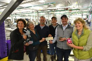 Sitka Sound Science Center Director Lisa Busch, left, and the center's board of directors receive a $75,000 check from Silver Bay Seafoods CEO Rich Riggs and plant manager Wayne Unger recently at SBS's new canning facility. From left are Busch, Linda Waller, Steve Clayton, Unger, Riggs, and Trish White. (Daily Sitka Sentinel Photo by James Poulson)