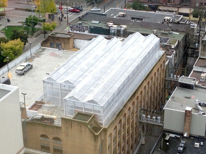 Rooftop greenhouses, such as this one on top of a parking garage in Vancouver, British Columbia, are becoming more popular around the world. The rooftop greenhouse project from the 2015 Sitka Health Summit is hoping this might be an option for Sitka, where land is at a premium. (Photo from http://www.cityfarmer.info/)