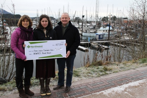 From left, Linda Behnken of the Alaska Longline Fisherman's Association and Anya Grenier of the Alaskans Own Seafood community supported fishery project receive a check for $4,500 from Michael Wittman of Northwest Farm Credit Services to help promote local seafood for Alaskans.