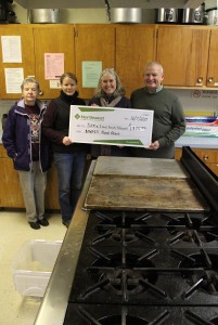 From left, Dorrie Farrell and Kristy Miller of the Sitka Kitch community rental commercial kitchen advisory team and Sitka Local Foods Network president Lisa Sadleir-Hart receive a check for $1,975 from Michael Wittman of Northwest Farm Credit Services to support a Sitka Kitch project to teach basic culinary skills to people wanting to get jobs in the food/restaurant industry. The classes will take place in March.