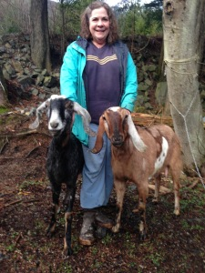 Bobbi Daniels with two goats (Photo courtesy of Lori Adams of Down-To-Earth U-Pick Gardens)