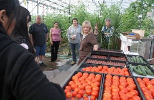 (Photo by Jeff Fay) Meriam Karlsson provides a tour of the greenhouse and hydroponic system near Pike's Waterfront Lodge.